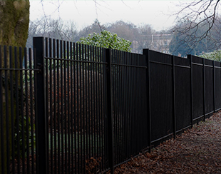 Commercial fencing surrounding an empty open area in Birmingham. The fencing is installed and supplied by Hodges & Lawrence.