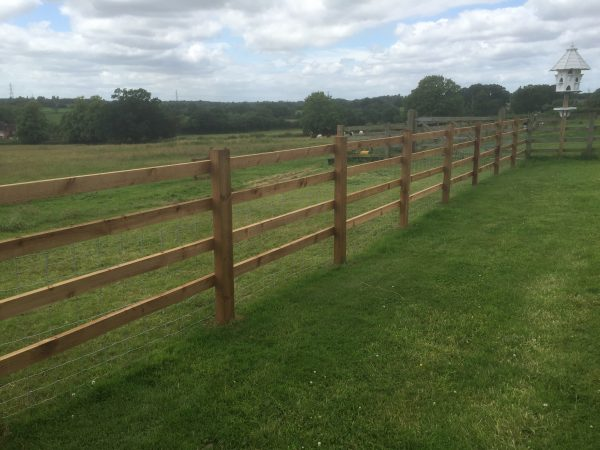 Wooden post and rail fencing perfect for commercial purposes.