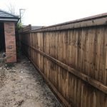 Wooden garden paling fencing alongside a new build area in Birmingham.