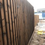 Tall wooden fencing panels stood in a fencing supply unit in Birmingham.