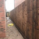 Wooden garden fencing beside a new build house in Birmingham.