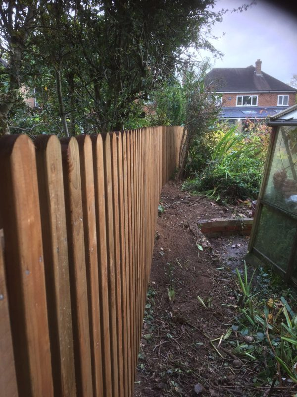 Paling wooden garden fencing surrounding a garden in Birmingham. The wooden fencing is perfect for providing security.