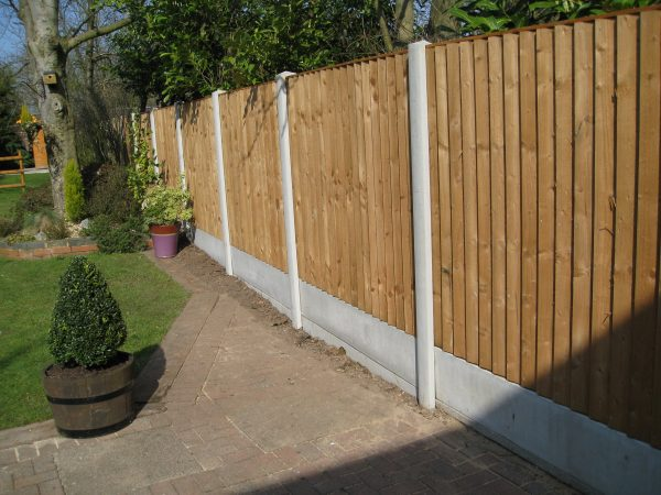 A garden in Birmingham surrounded by a fence. Fence panels are wooden with concrete posts in between.