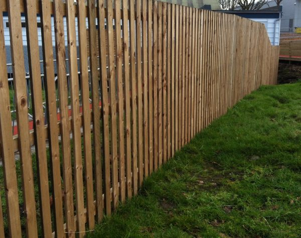 Wooden garden fencing standing in a garden in Birmingham. Paling fencing perfect for domestic use.