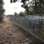 Steel security commercial fencing alongside a walkway in Birmingham.