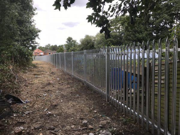 Steel security commercial fencing alongside a walkway in Birmingham.