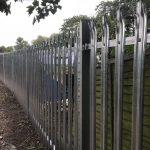Steel commercial fencing, securing a private space.
