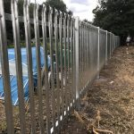 Steel commercial fencing alongside a public walkway in Birmingham.