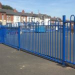 Blue commercial railings surrounding a yard in Birmingham.