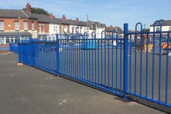 Blue commercial railings surrounding a yard in Birmingham.