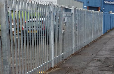 Steel commercial fencing surrounding an industrial area in Birmingham.