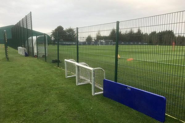 Commercial fencing surrounding a football pitch in Birmingham.