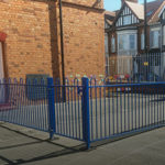 Bespoke blue railings surrounding a schoolyard in Birmingham.
