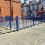 Blue steel commercial railings surrounding a schoolyard in Birmingham.