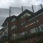 Green double mesh fencing. These commercial fences are used secure office buildings in Birmingham.