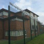 Double mesh fencing surrounding offices in Birmingham. These commercial fences provide great security.