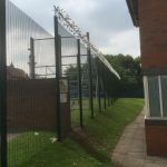Double wire mesh fence panel with security spikes. This commercial fencing is perfect for securing industrial areas / prisons.