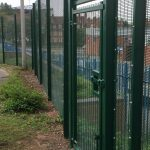 Green double wire mesh gates, with secure locking system. These commercial gates are perfect for securing school yards.