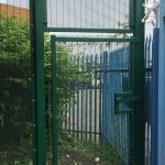 Green double wire mesh gates. These commercial gates are used to keep vehicles secured.