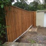 Wooden fence with feather edge fence capping.