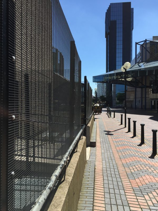 Double mesh fencing in black. This commercial fencing provides security for a area in Birmingham city centre.