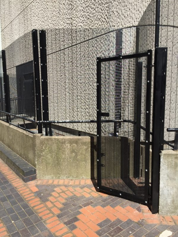 Black mesh fencing providing security for commercial buildings.