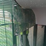 Green double mesh commercial fencing.