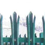 Green steel palisade fencing.