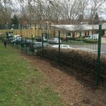 Double mesh fencing being assembled around a car park in Birmingham. Commercial fences offer a great security solution.