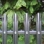 Installed black steel palisade fencing. The commercial fence panel provides high quality security.