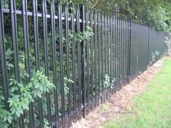 Back steel palisade fencing. Commercial fencing provides a quality security solution.