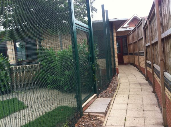 Green double mesh fencing. This commercial fencing is perfect for securing office buildings.