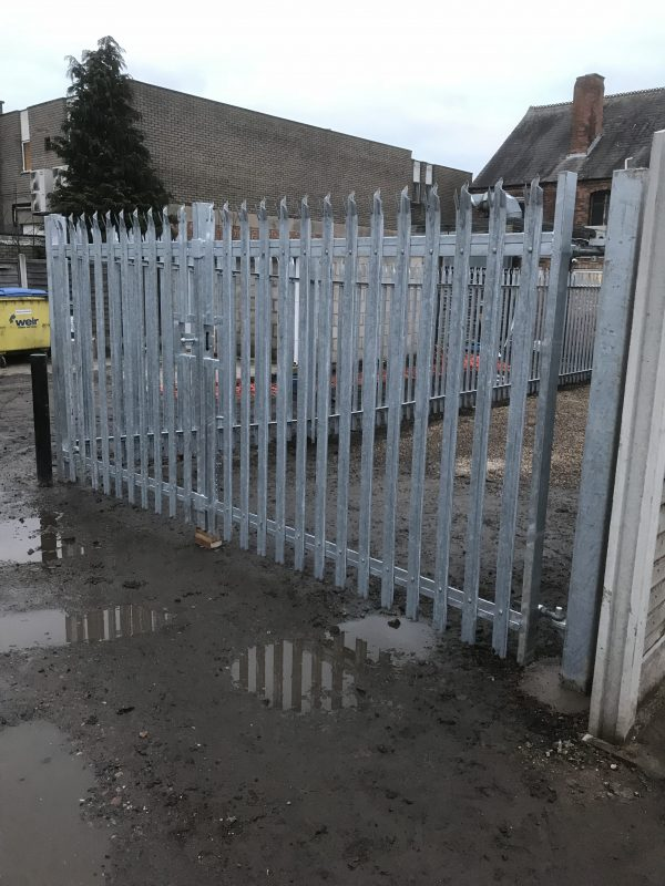 Steel palisade fencing. Commercial fencing provides high quality security for businesses and commercial properties.