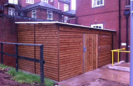 Commercial shed in a outside space. The commercial shed is used as a simple storage solution.