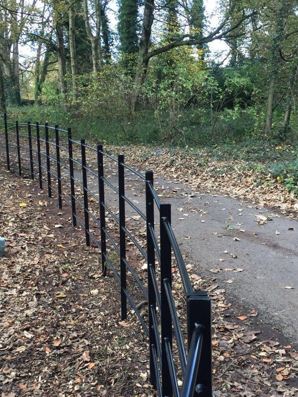 Black bespoke railings. The bespoke railings provide security for private areas.