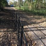 Black bespoke railings alongside a public walkway.