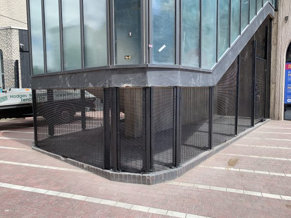 Commercial fencing being assembled around a property in Birmingham. Double wire mesh provides a secure option for businesses.