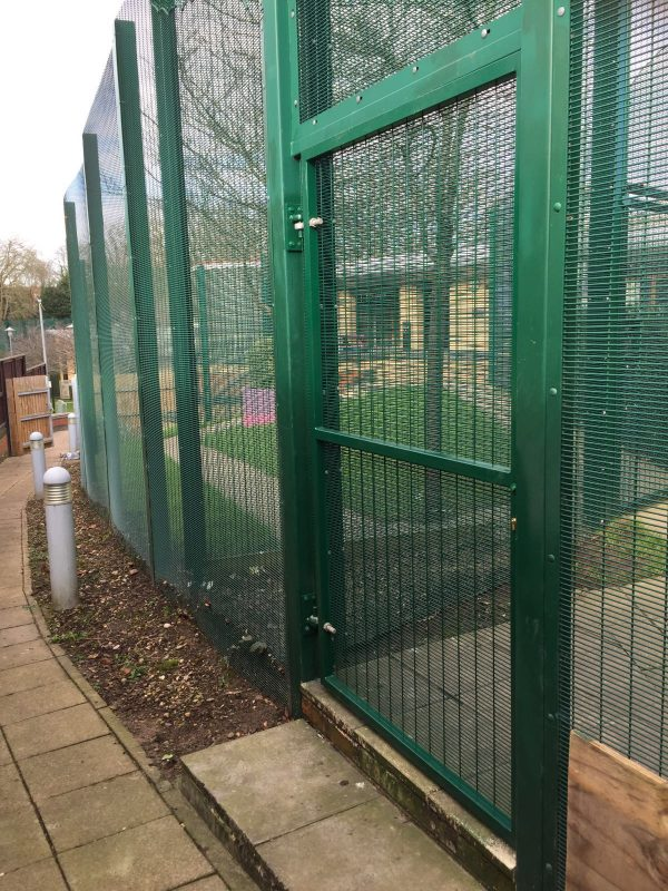 Green double mesh fencing. Commercial fencing provides a secure security solution.