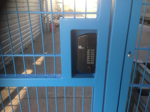 Blue wire mesh gates with secure coded lock.