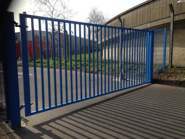 Blue vertical bar steel gate. Commercial gates used to secure a commercial property,