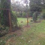 Chain link fencing with wooden fence posts. Commercial fencing provides a quality security solution.