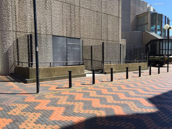 Black double mesh fencing securing a commercial building. This commercial fence provides necessary security.