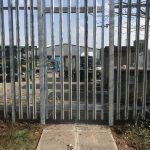 Steel palisade gates in front of an industrial unit. These commercial gates are perfect to keep industrial areas secure.