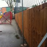 Commercial fencing providing security to a school yard.