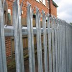 Steel palisade fencing used to secure a commercial building.