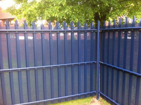Blue steel palisade fencing.