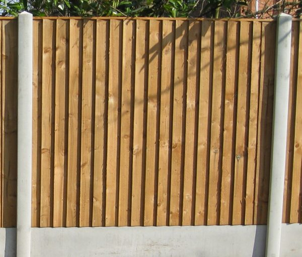 A wooden fence with close board fence panels.