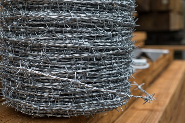 A large roll of barbed wire. This barbed wire can be used to secure commercial and domestic properties.