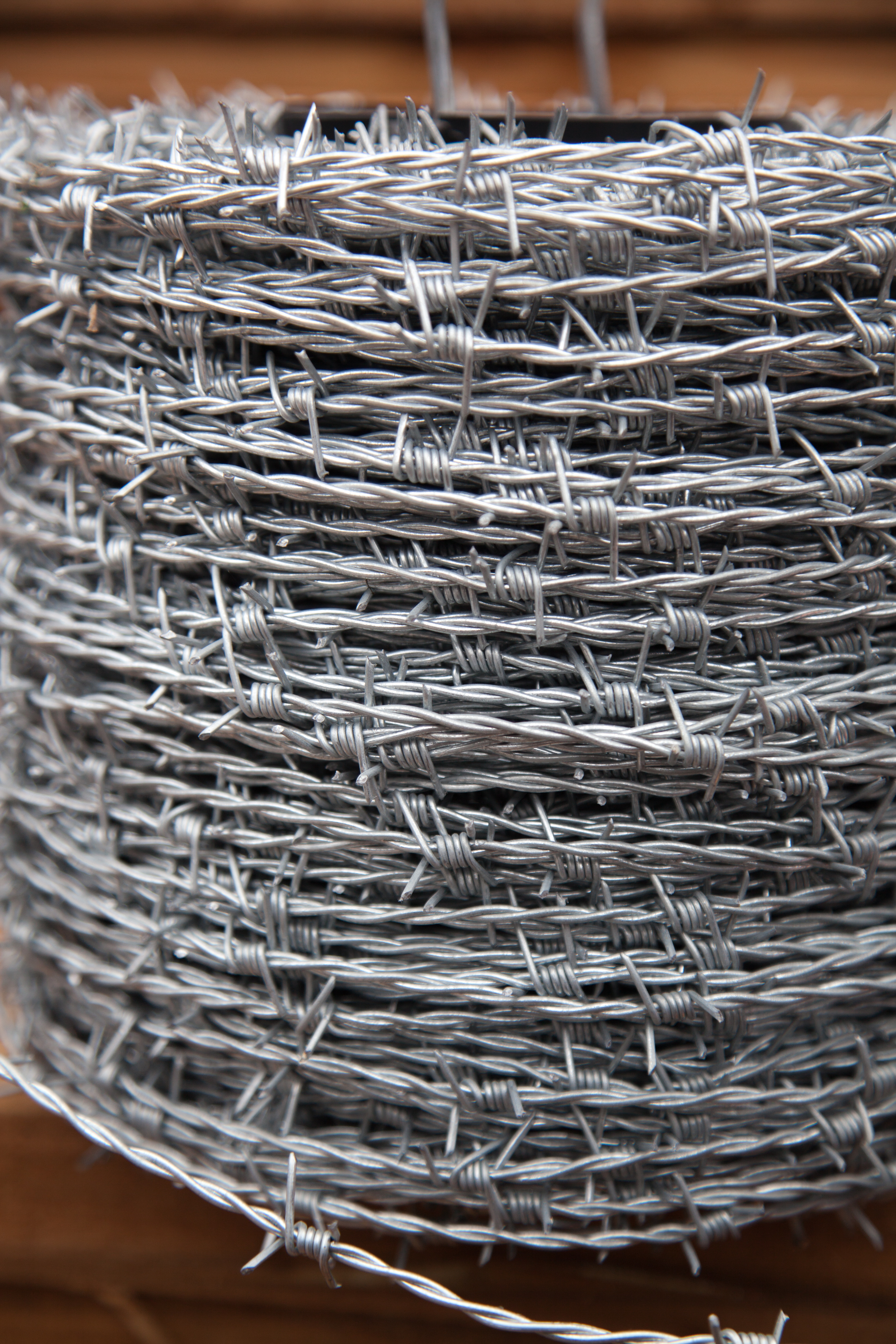A roll of barbed wire. The provides security and can be used on the top of fencing and walls.
