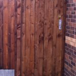 A wooden gate with feather edge boards and a pre-clad timber gate frame.